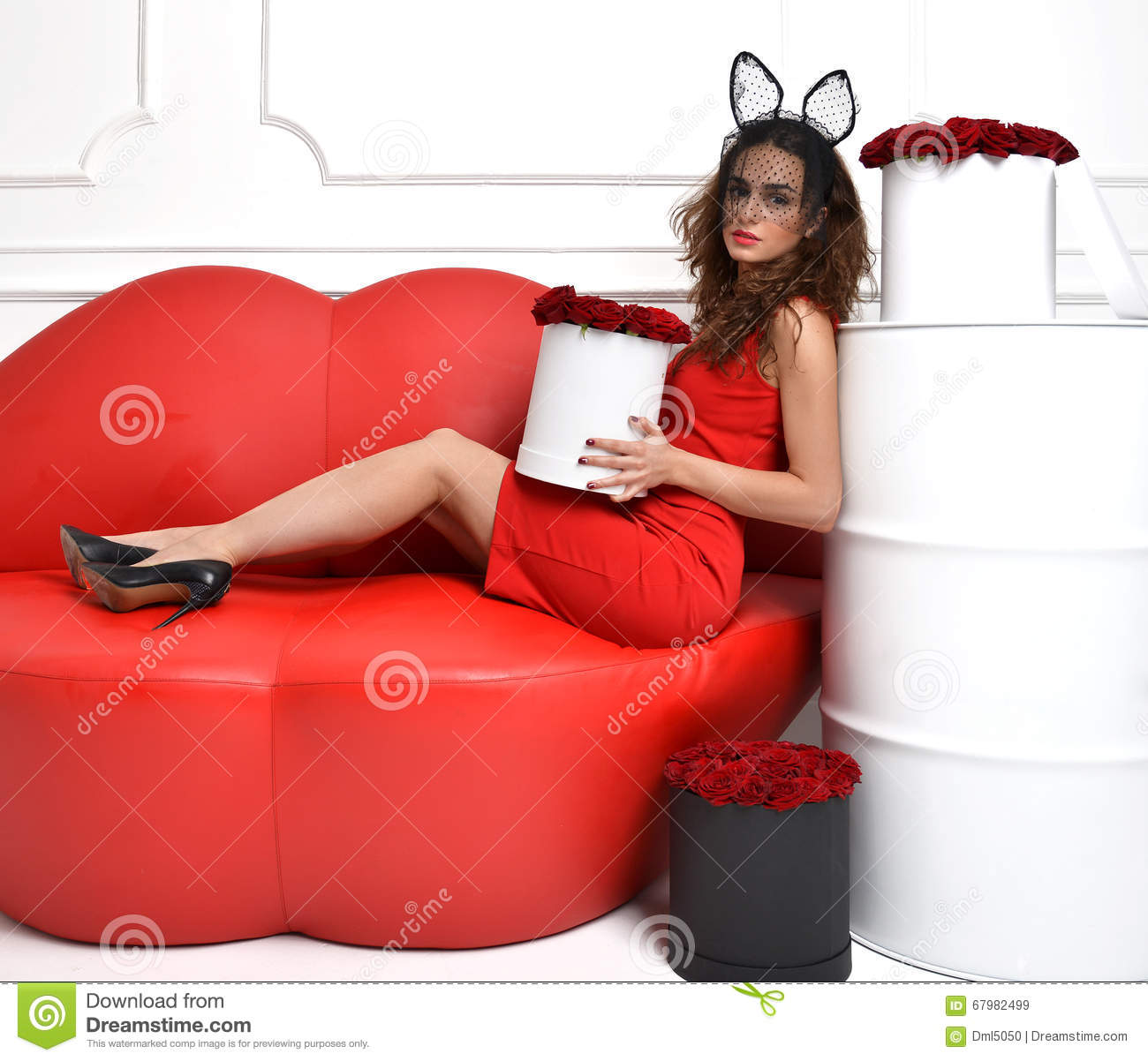 Woman Lying On Red Lips Sofa Couch And Red Dress With