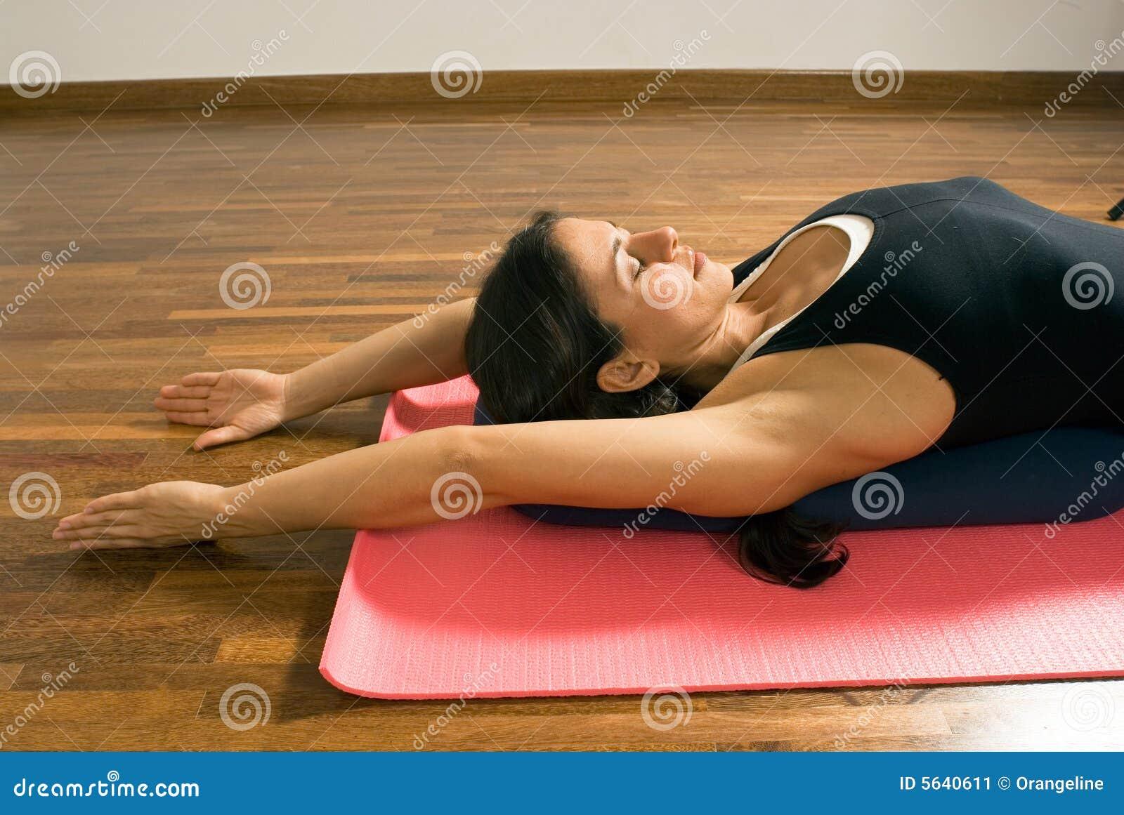 Woman Lying On Yoga Mat Horizontal Stock Image Image