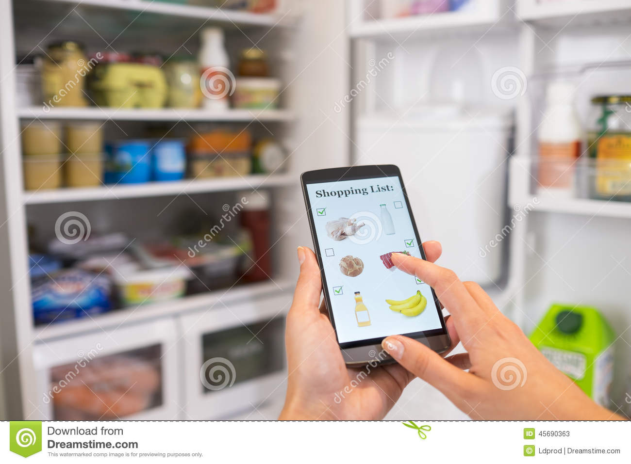 Woman Makes Her Shopping List On His Smartphone Connected