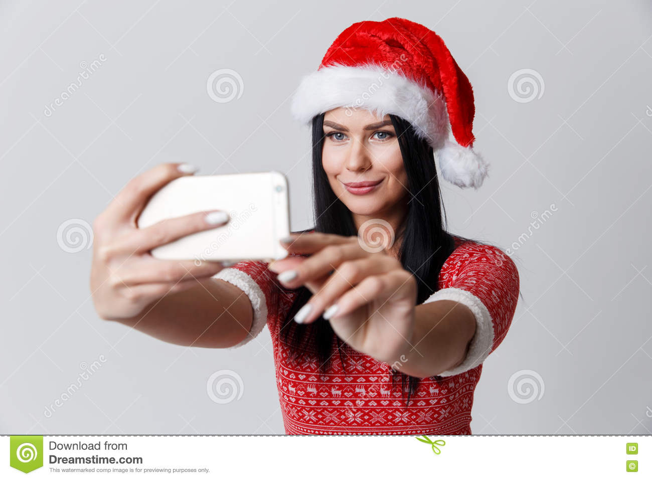Woman makes photos in hat