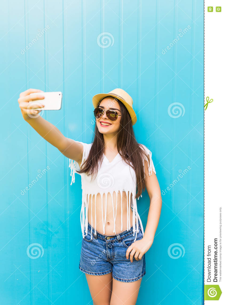Woman Makes Self Portrait On Smartphone Over City Color