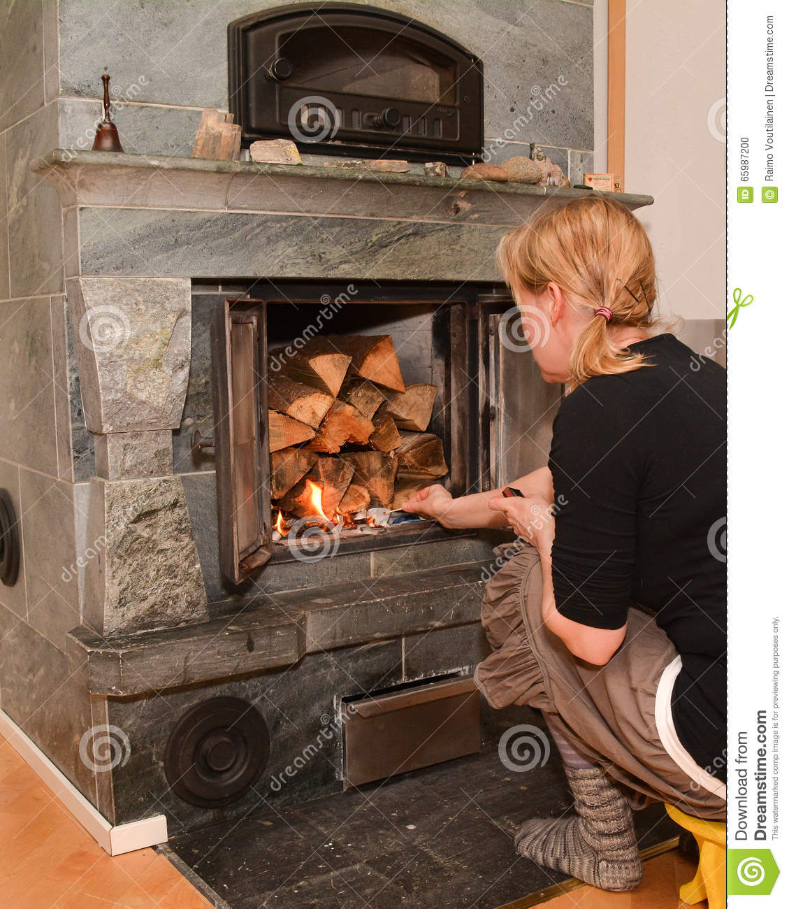 Woman Making Fire On Fireplace Stock Photo Image Of Cheerful