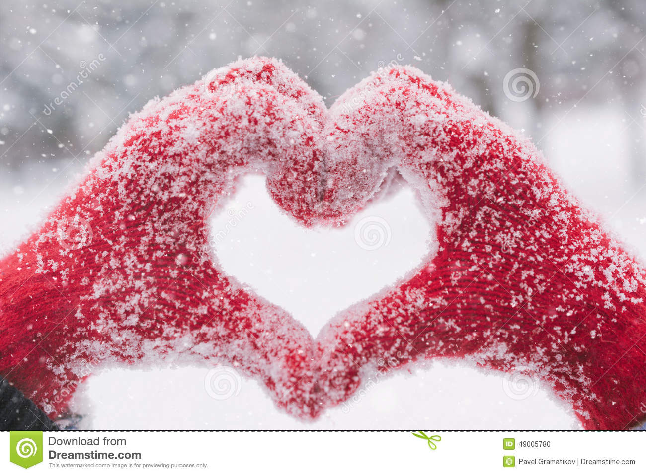Heart hands stock photos royalty free pictures woman making heart symbol with snowy hands with snow falling stock photo biocorpaavc