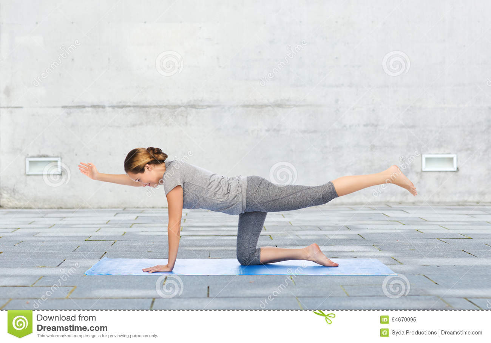 Woman Making Yoga In Balancing Table Pose On Mat Stock