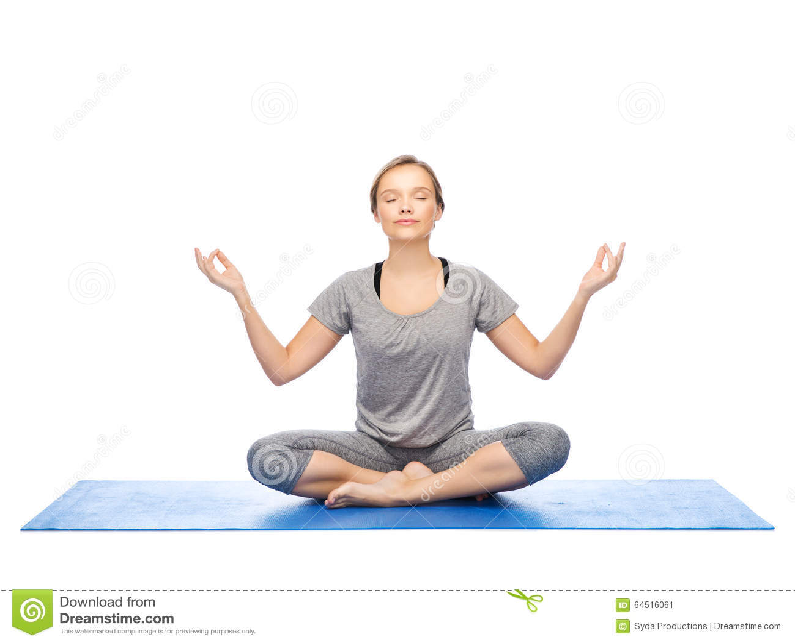 Woman Making Yoga Meditation In Lotus Pose On Mat Stock