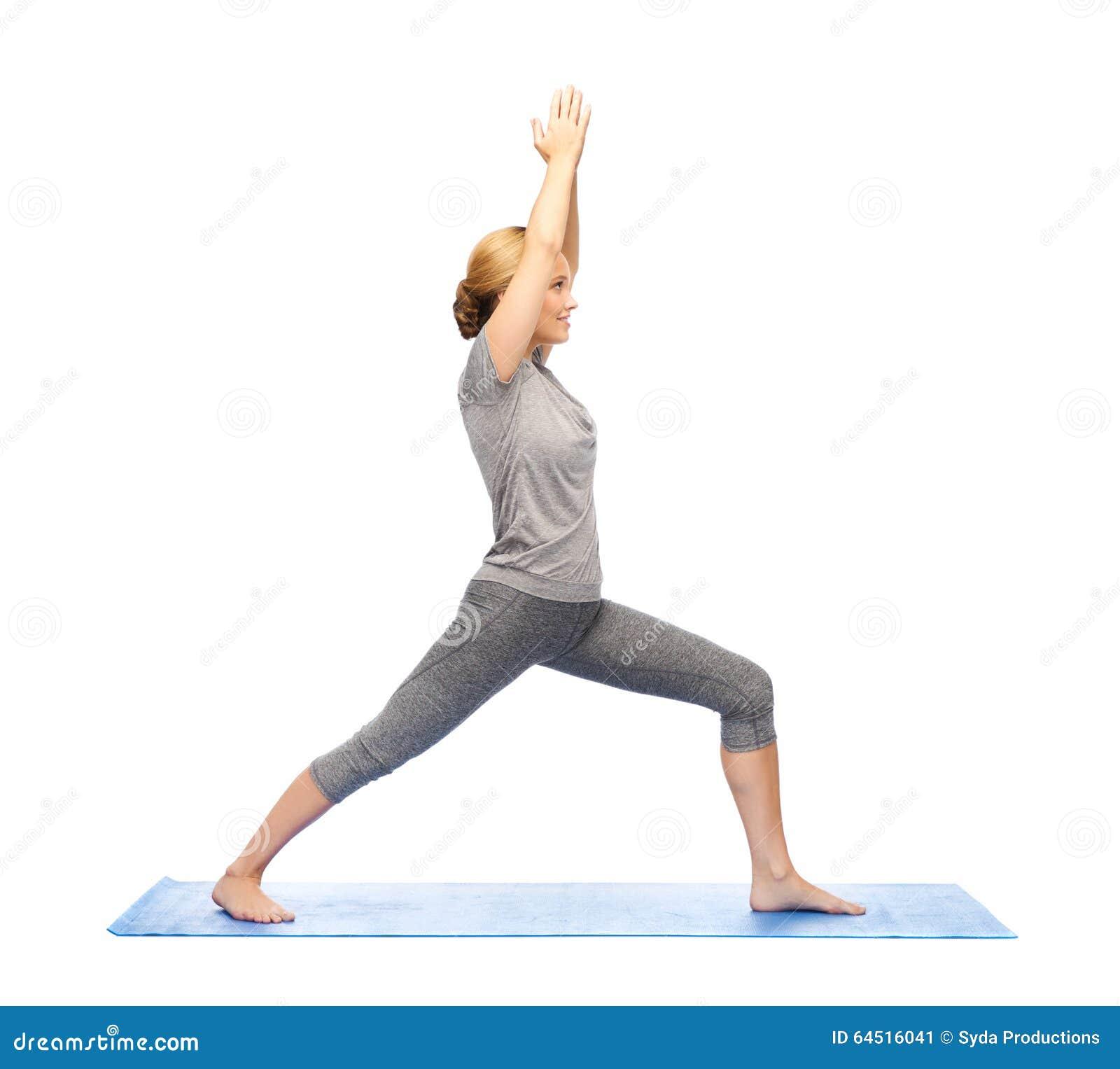 Woman Making Yoga Warrior Pose On Mat Stock Photo Image