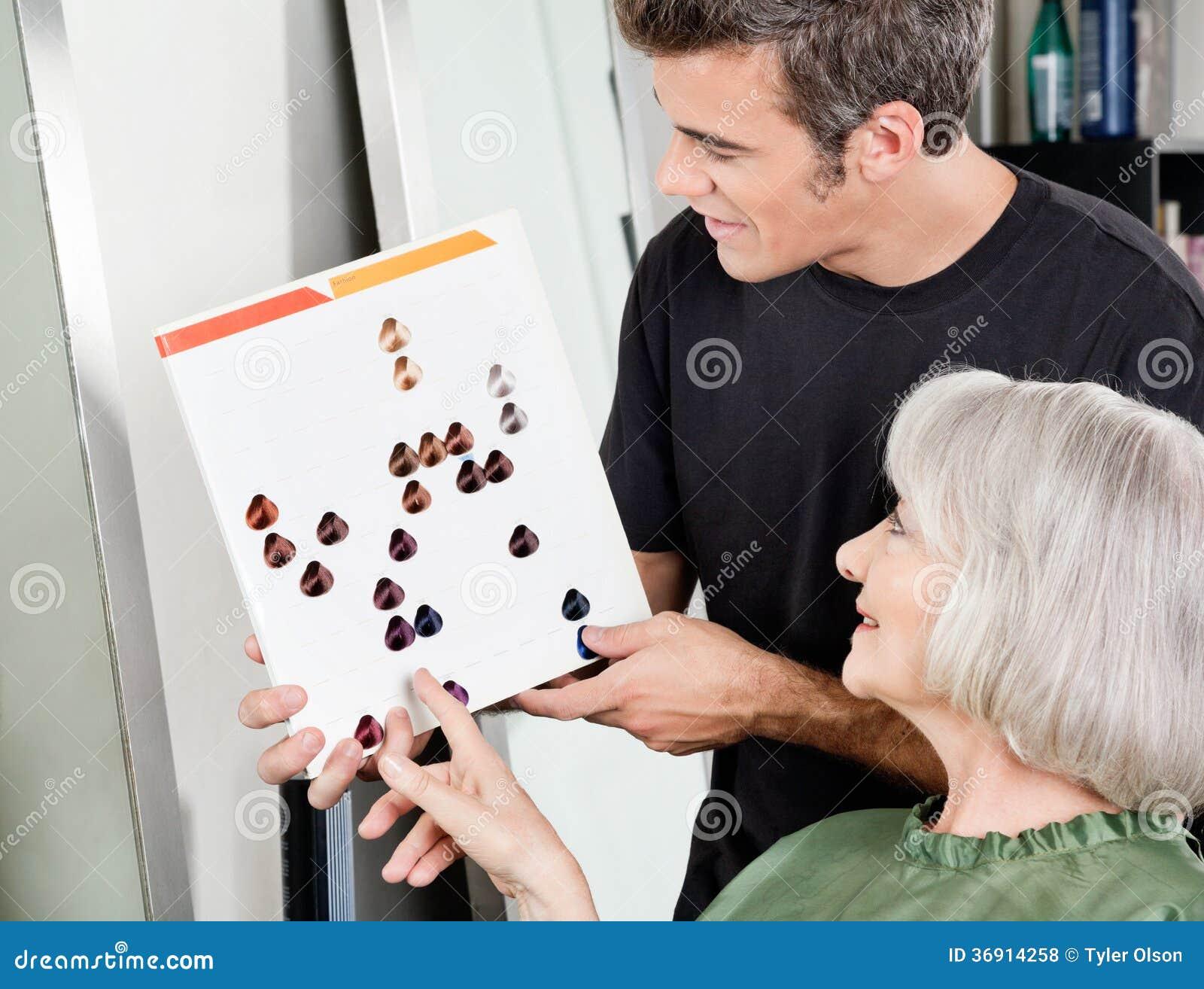 Woman with male hair stylist selecting hair color stock - Stylistics hair salon ...