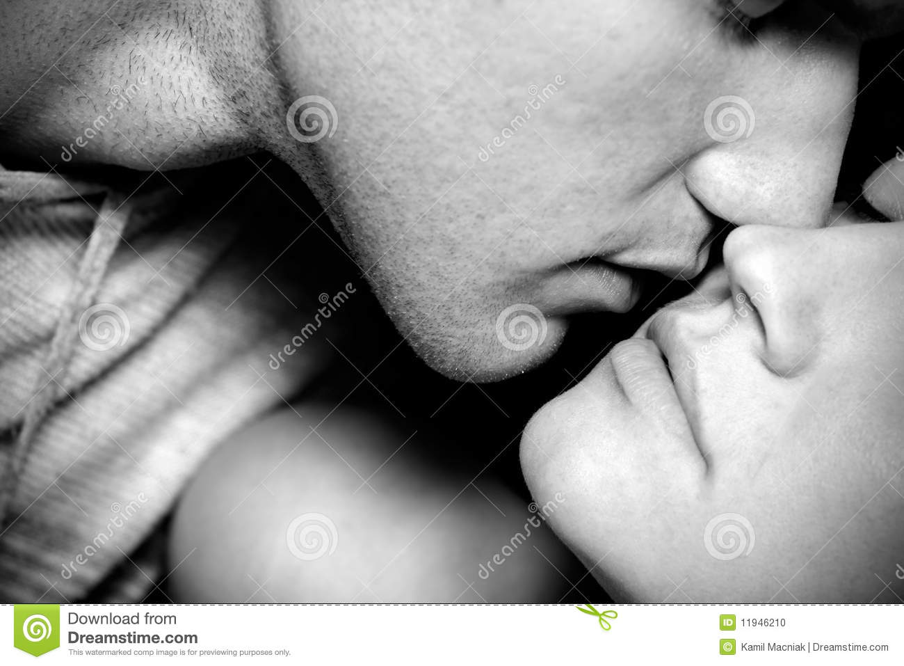 Black and white closeup of woman and man kissing
