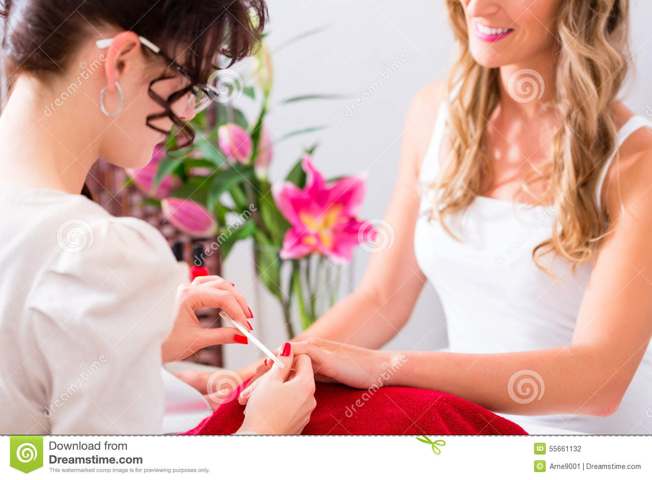 Woman At Manicure In Nail Parlor With File Stock Photo - Image of ...