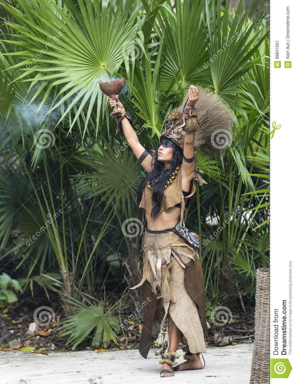 Woman in Maya indian costume in Tulum, Mexico
