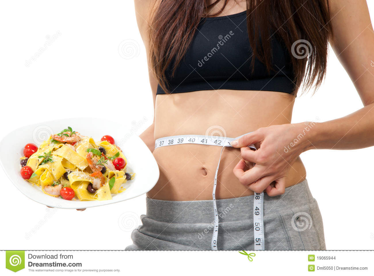 Woman measuring waist and holding diet food