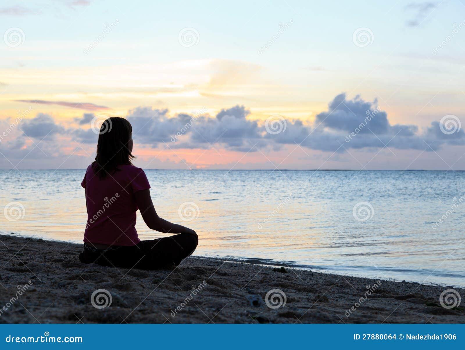 Woman meditation on the beach