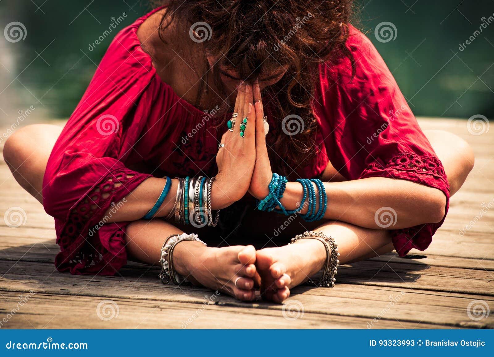 Woman in a meditative yoga position closeup