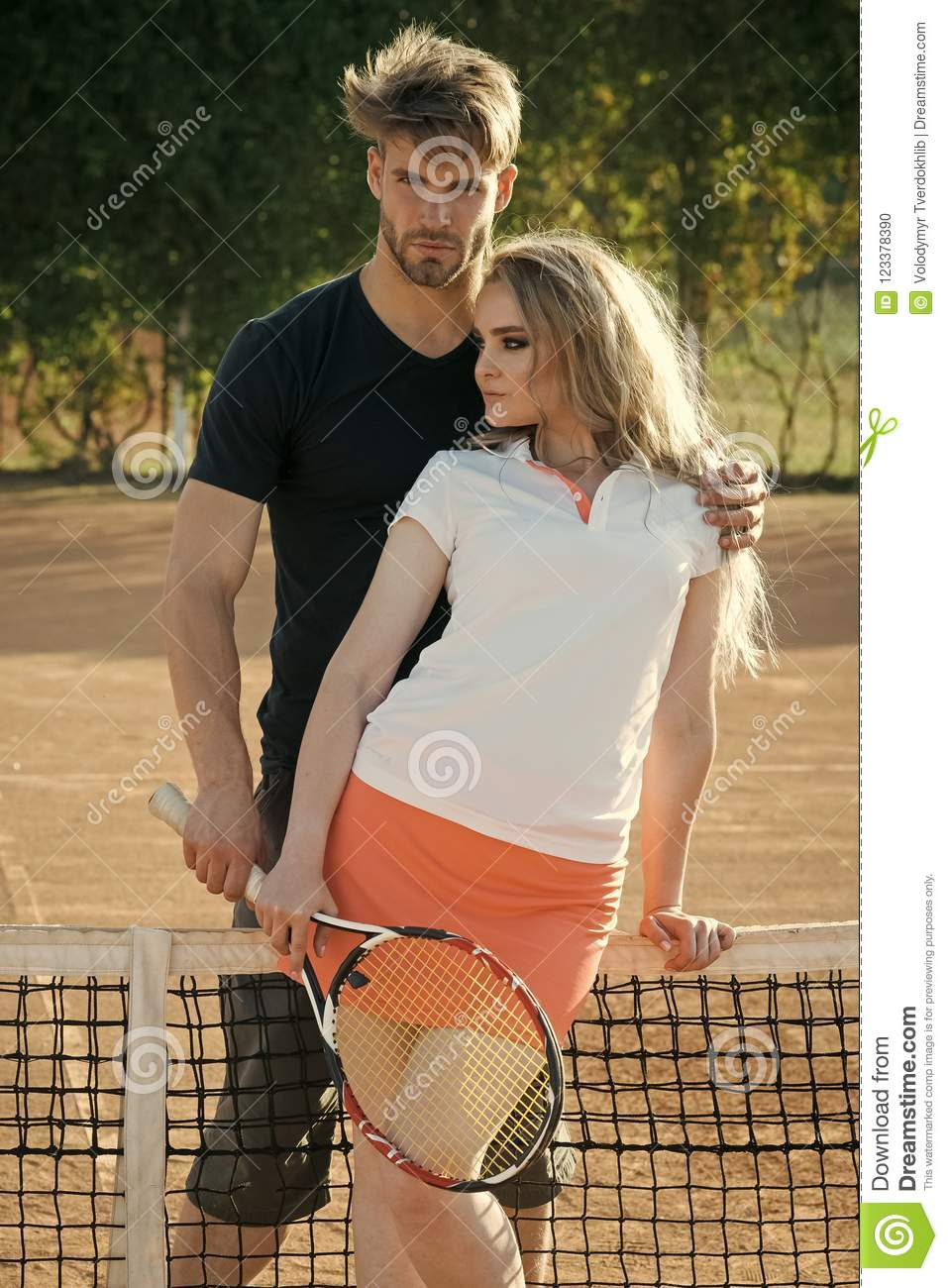 Woman And Man Athletes Hold Tennis Racket Stock Photo - Image of concept,  racket: 123378390