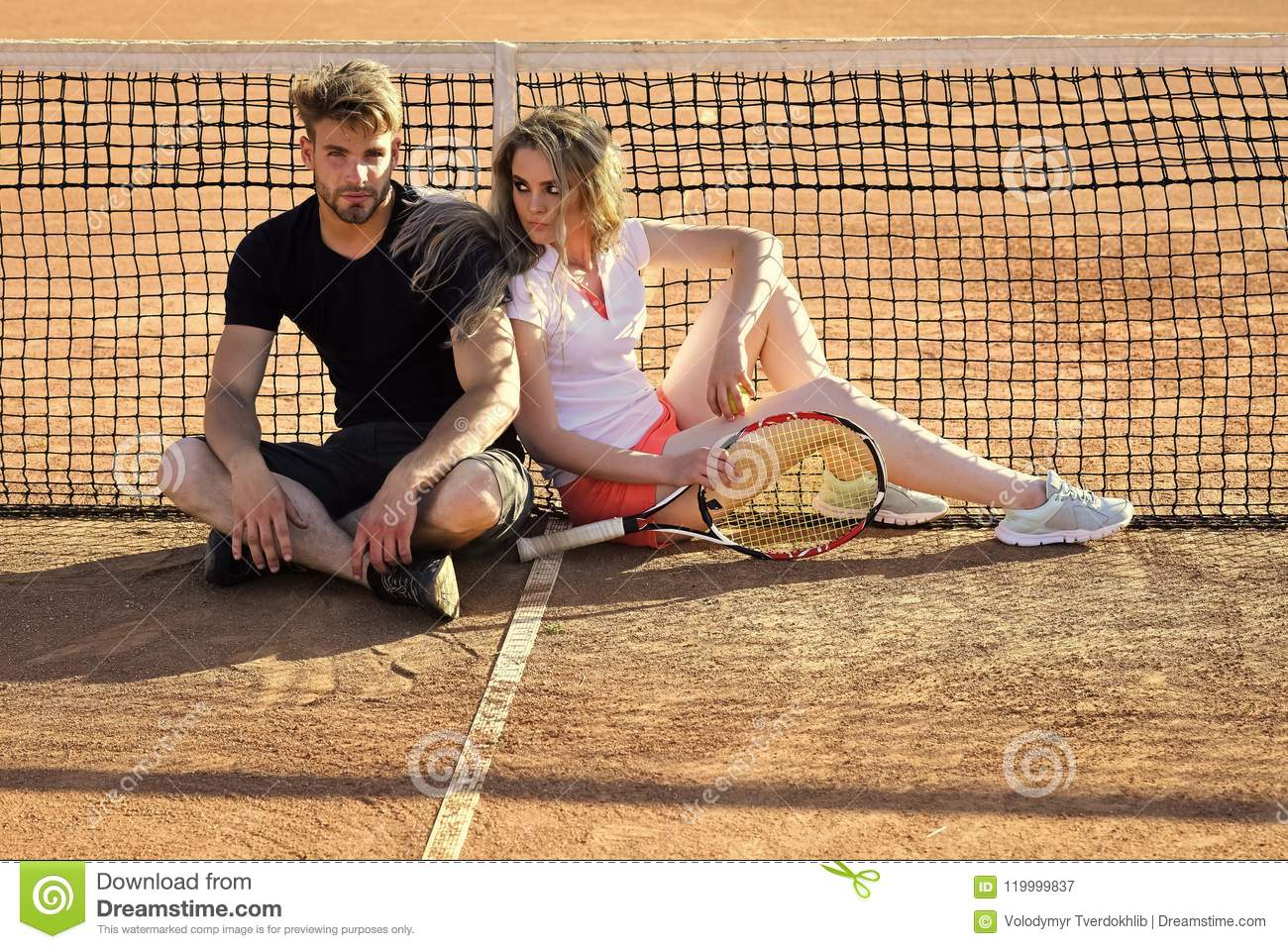 Woman And Man Tennis Players With Racket  Couple In Love Sit At