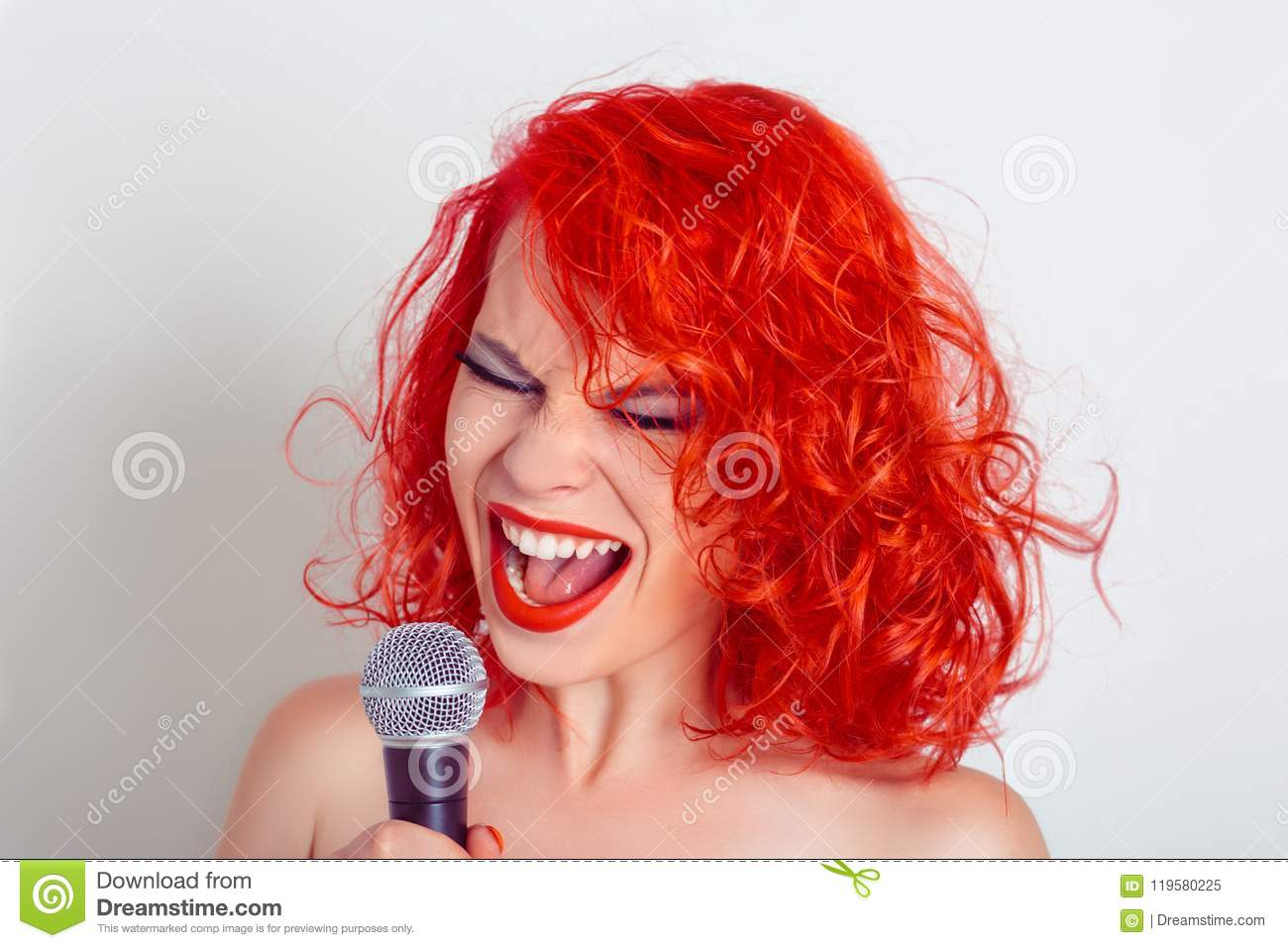 Woman with Microphone. Female funny singer screaming on mic