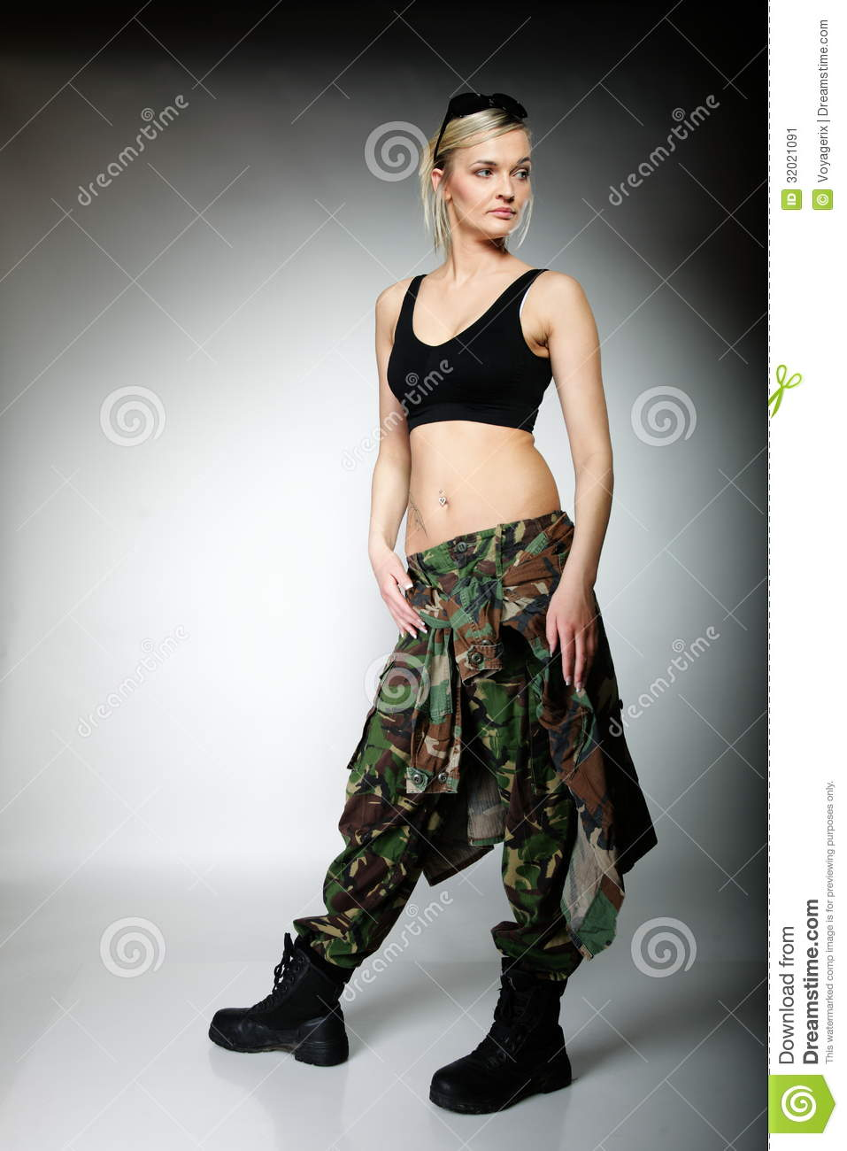 Full length woman in military clothes army girl on gray background