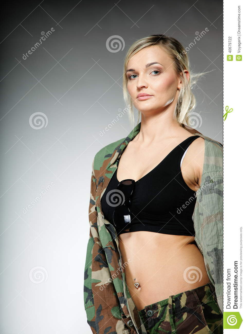Woman in military clothes army girl on gray background