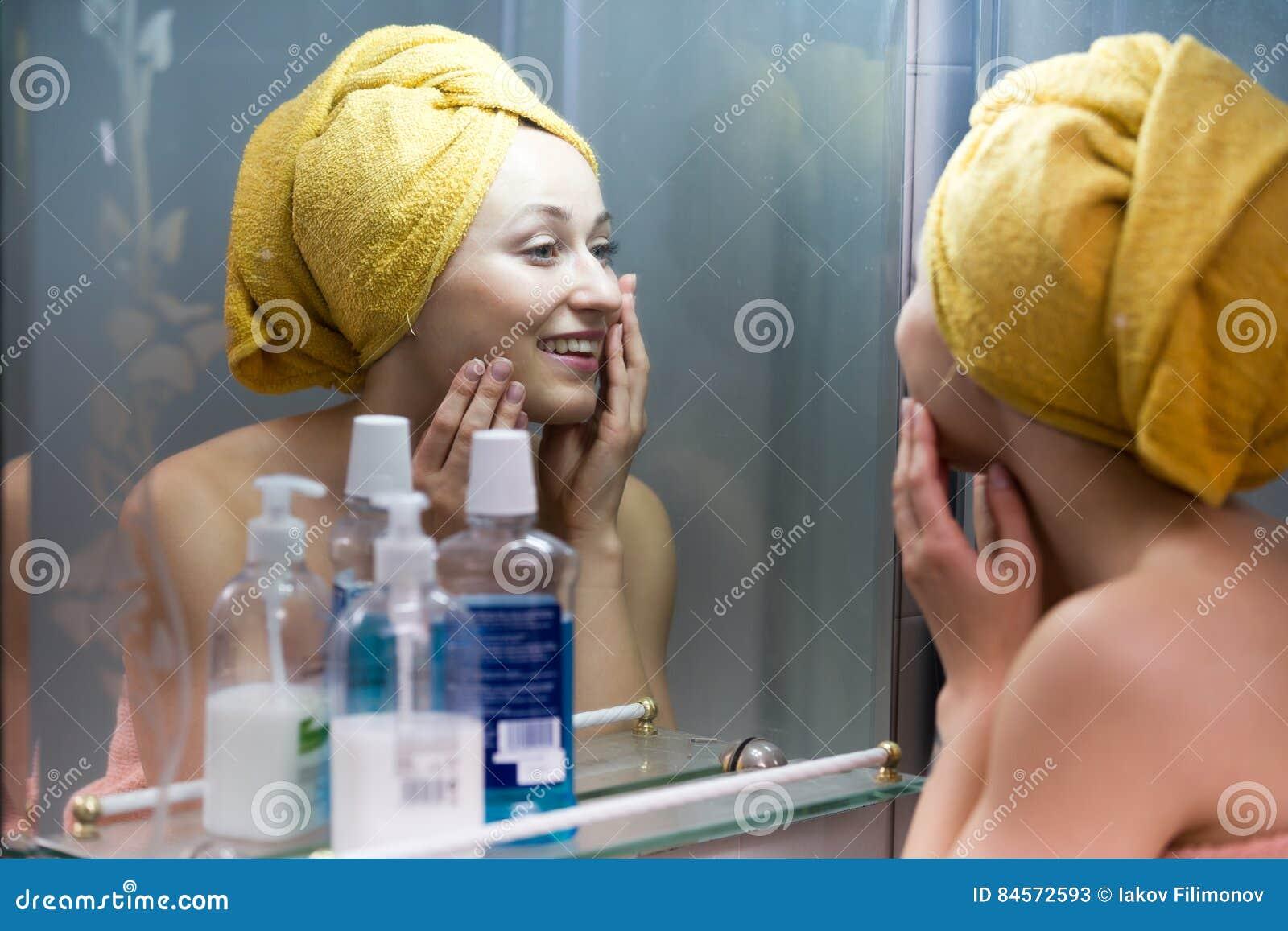 Woman mirror bathroom