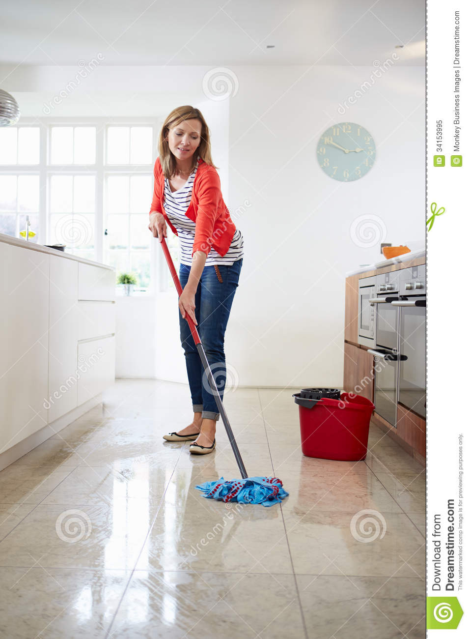 Woman Mopping Kitchen Floor Royalty Free Stock Photo