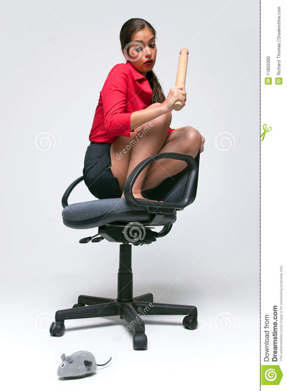 Woman with a mouse phobia stock photo image of adult 11850390
