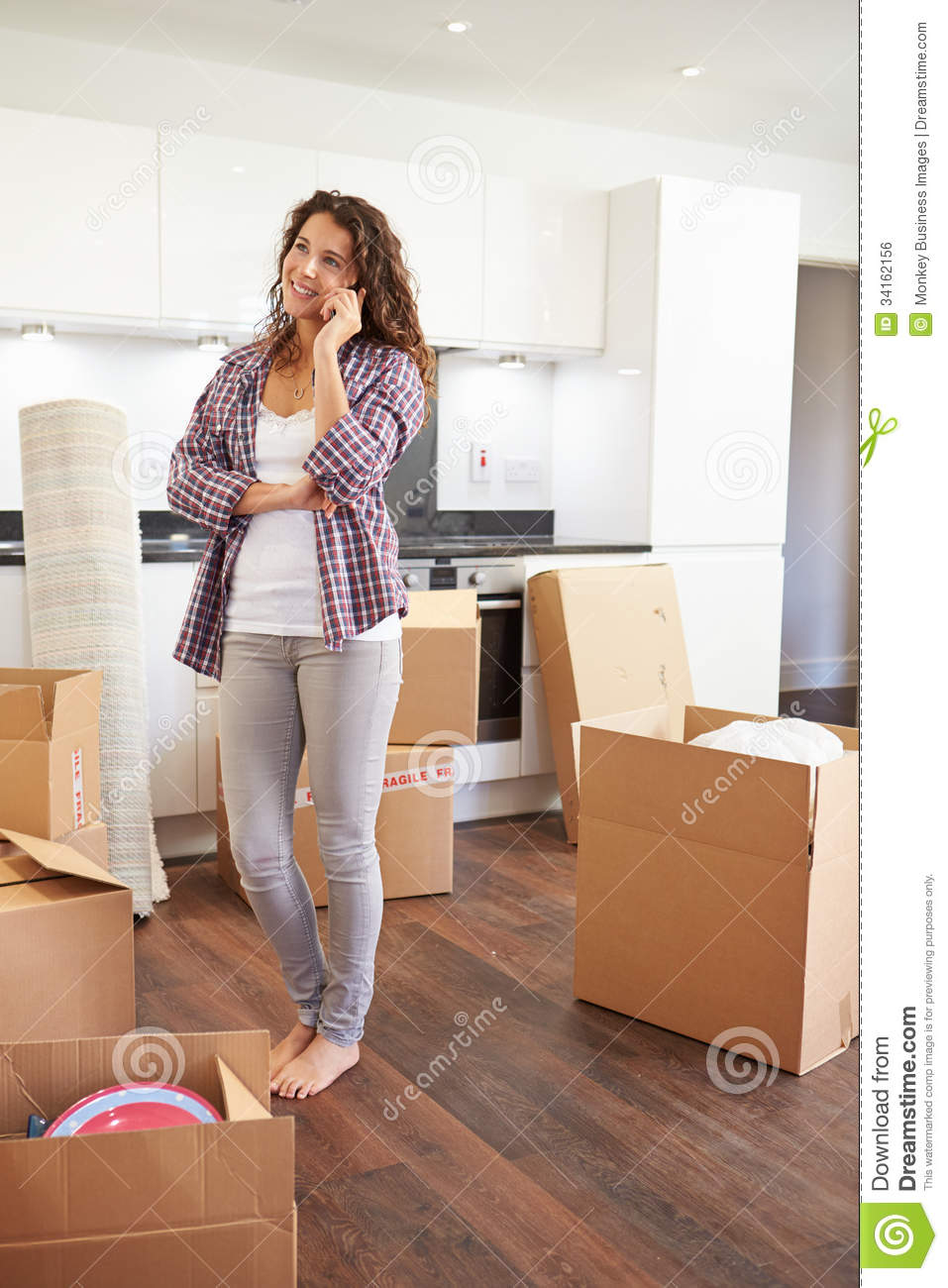 Woman Moving Into New Home Talking On Mobile Phone Royalty