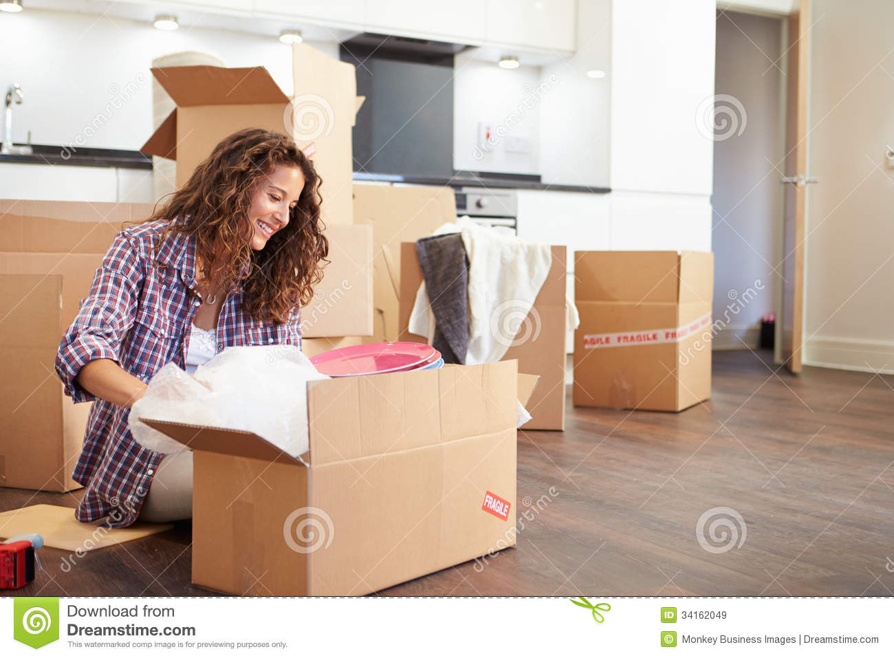 image A girl unpacked from suitcase