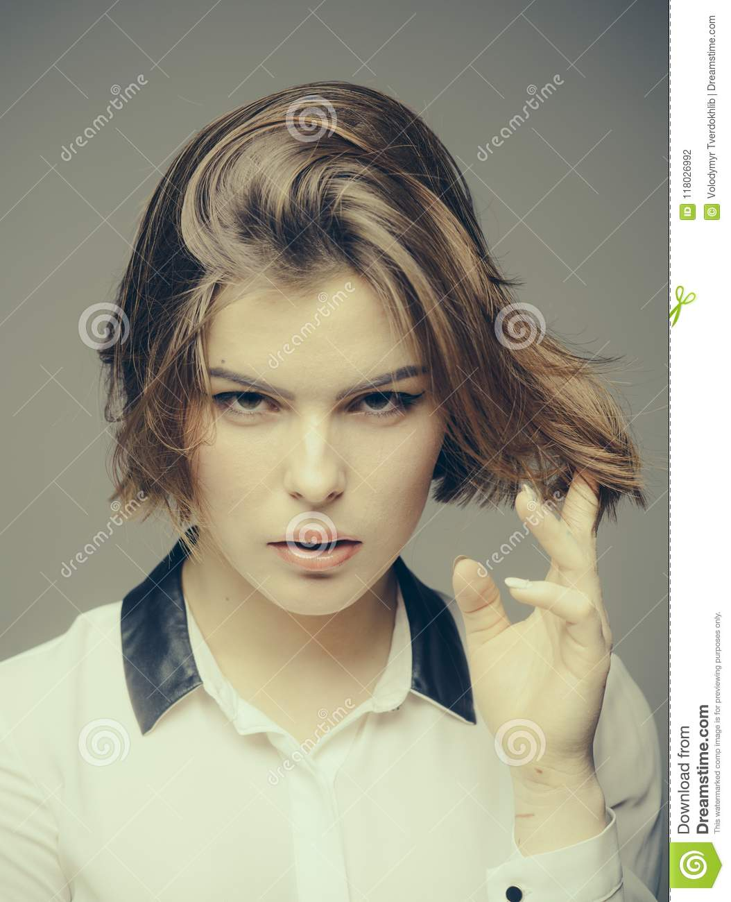 Woman On Mysterious Face Touches Her Hair Grey Background Girl