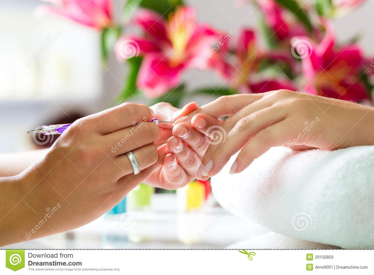woman in nail salon receiving manicure royalty free stock
