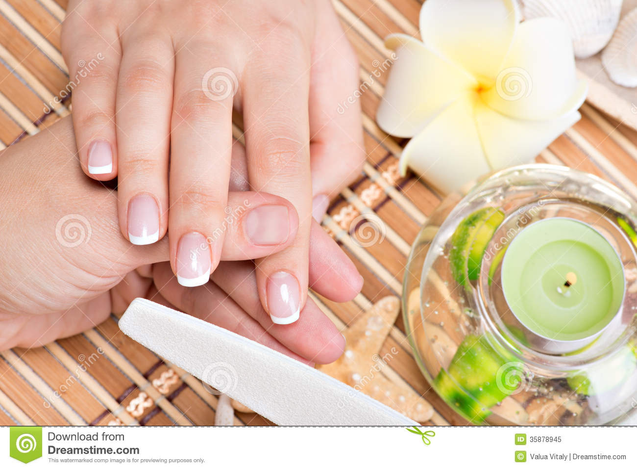 Woman in a nail salon receiving manicure royalty free for Abstract salon tucson