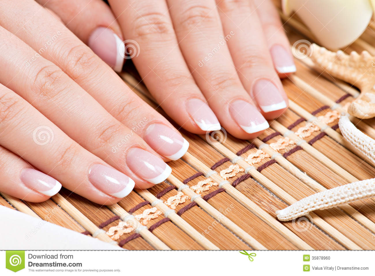 Woman in a nail salon receiving manicure stock photo for Photo salon