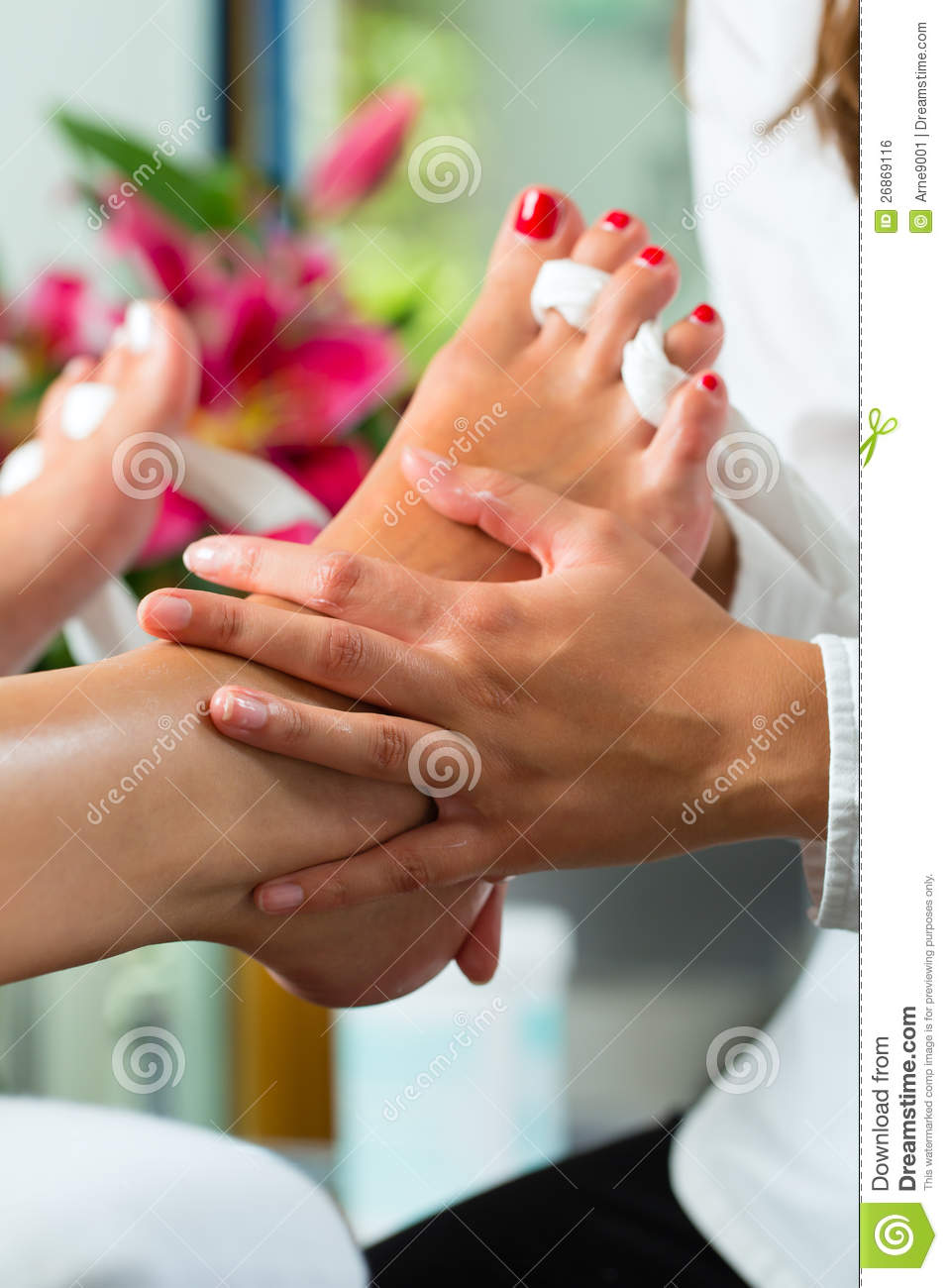 Woman In Nail Studio Receiving Pedicure Royalty Free Stock