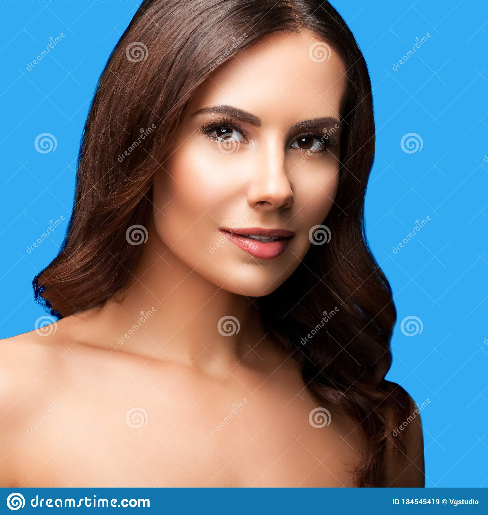 Beautiful Young Woman With Naked Shoulders Smiles Stock