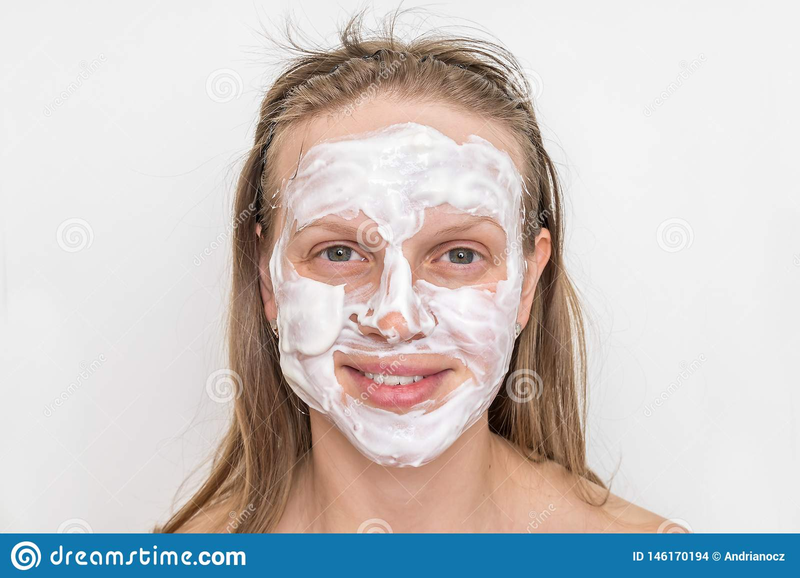 Woman with natural white cream mask on her face
