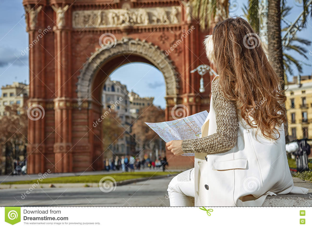 Map Of Spain Near Barcelona.Woman Near Arc De Triomf In Barcelona Spain Looking At Map Stock