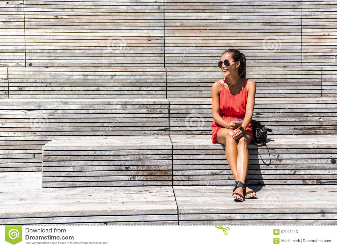 Woman in New York relaxing on bench on High Line