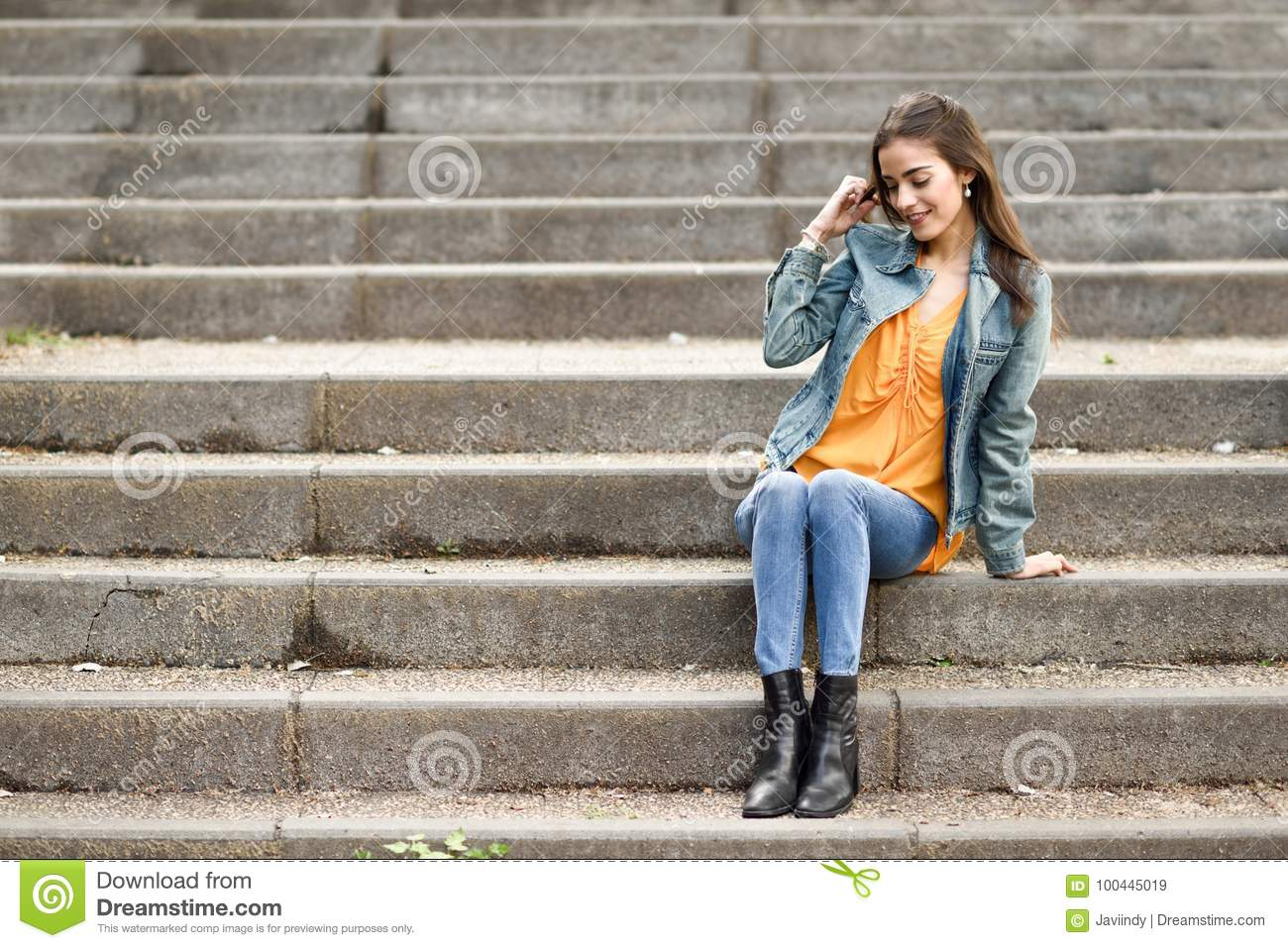 Woman With Nice Hair Wearing Casual Clothes In Urban Steps Stock