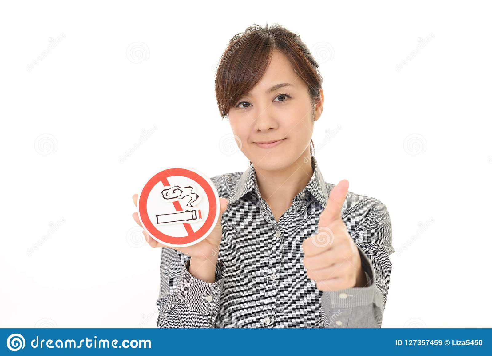 Woman holds non smoking sign