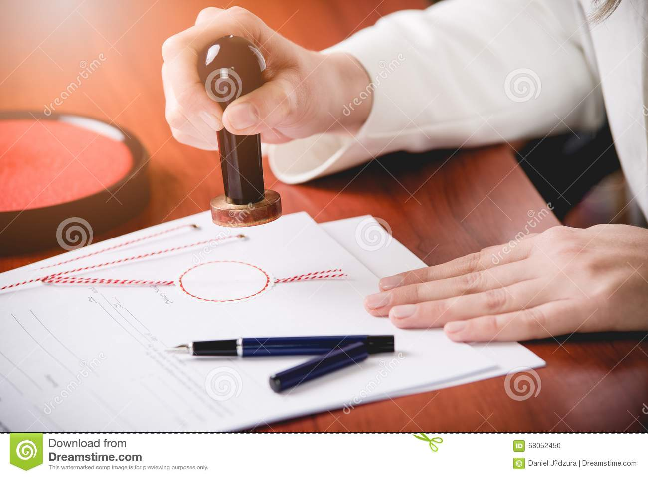 Woman Notary Public stamping the contract