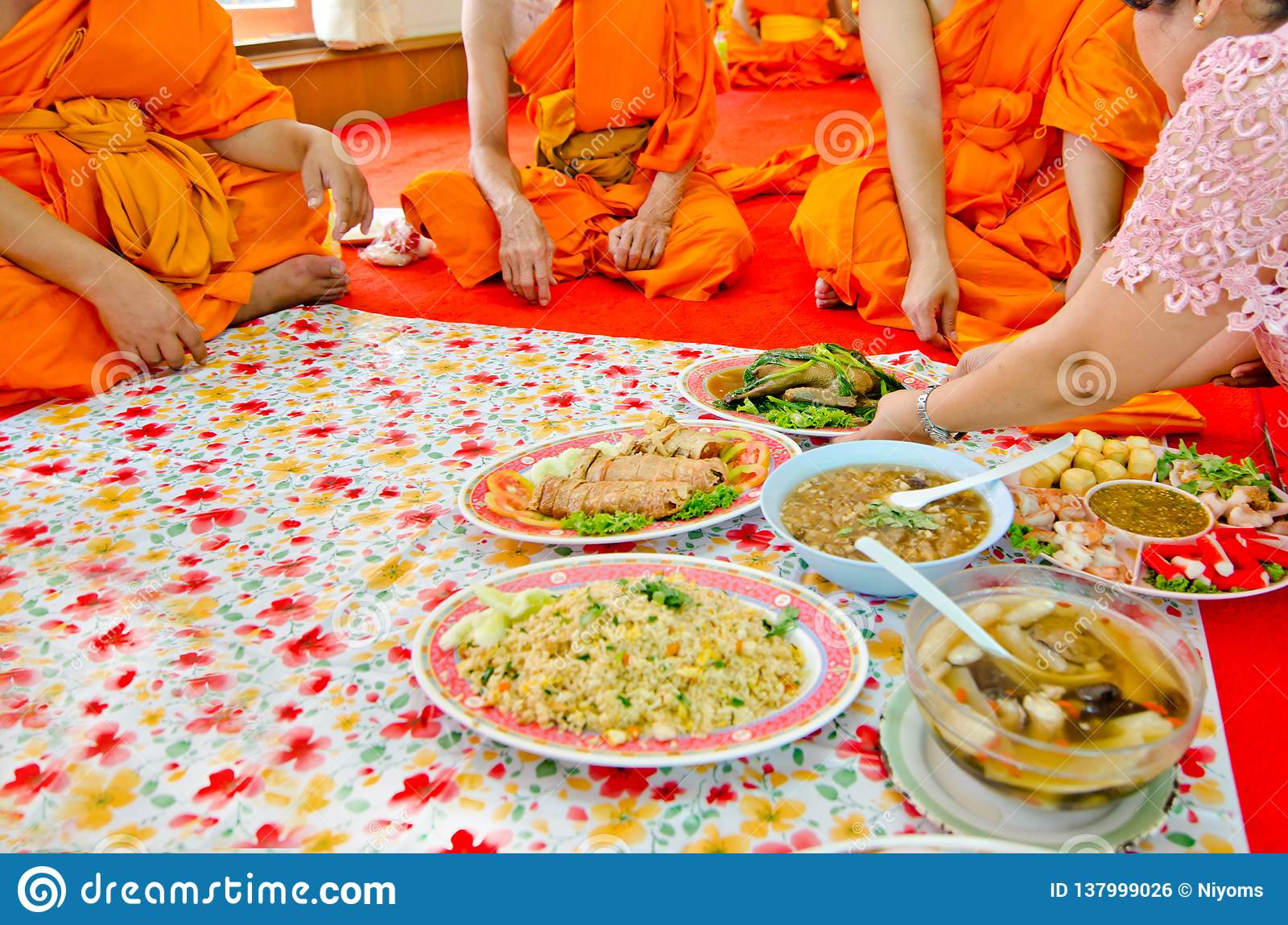 Offering foods to monks in Thai culture