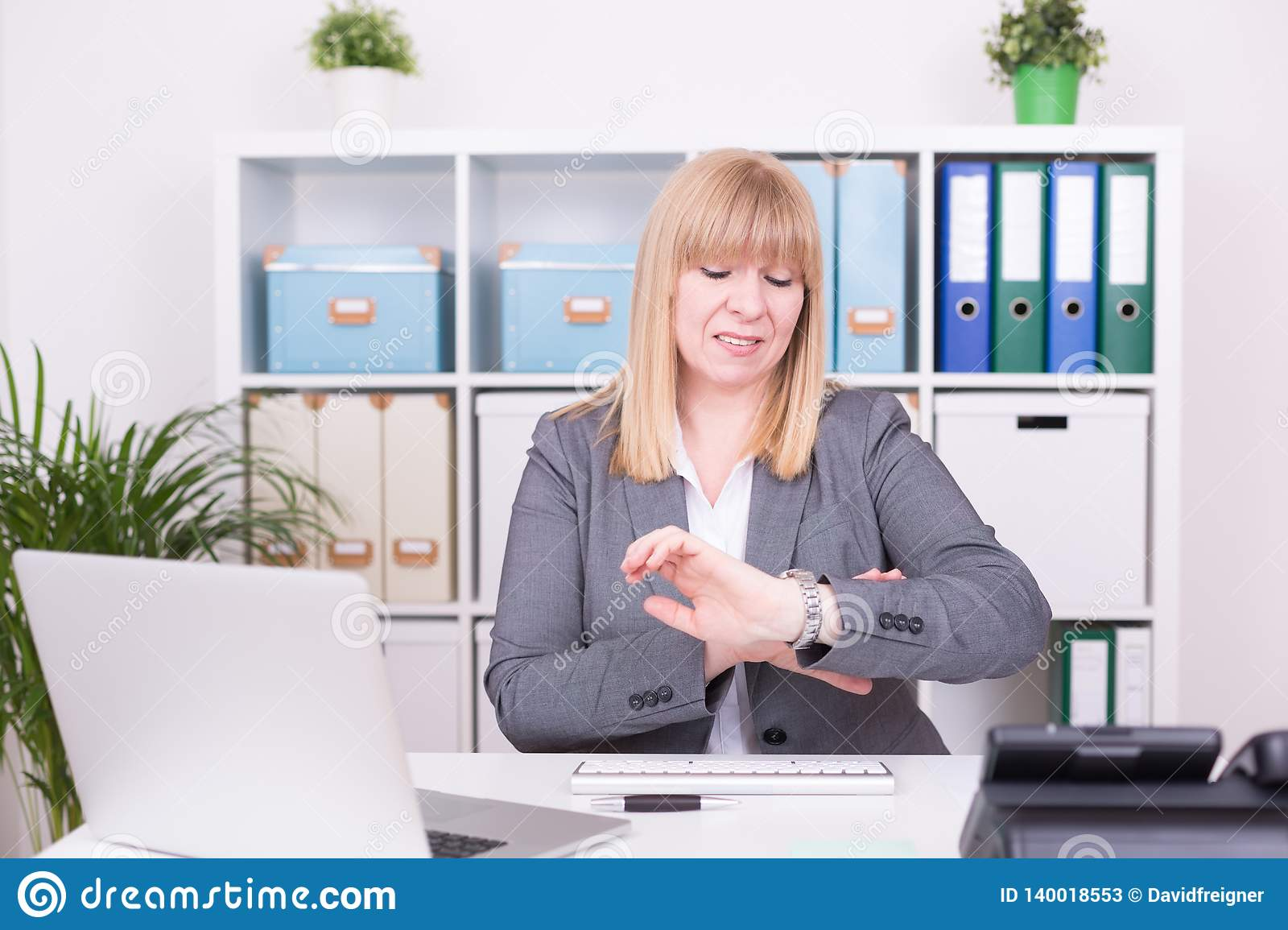 Woman at the office having time pressure. Business concept