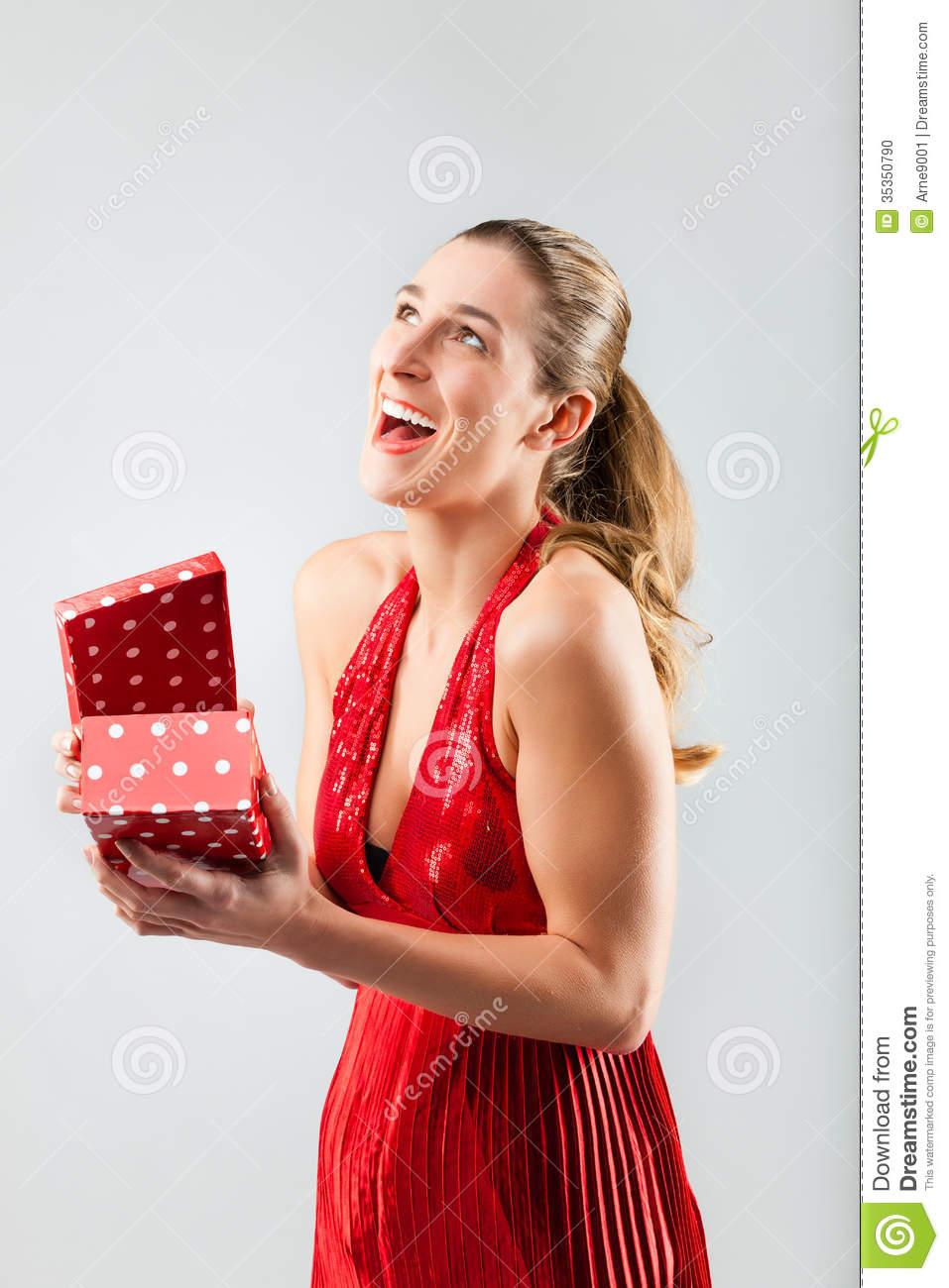 Woman Opening The Gift And Is Happy Stock Photo - Image ...