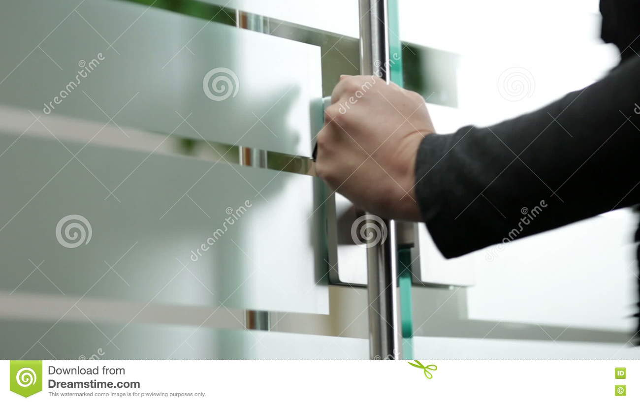 Attractive Woman Opening Glass Door To Office Stock Video   Video Of People,  Consultant: 76990731