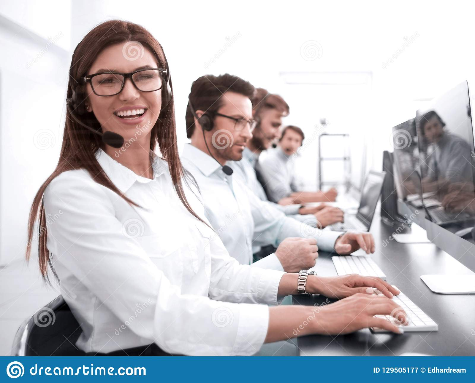 Woman operator in the workplace at the call center