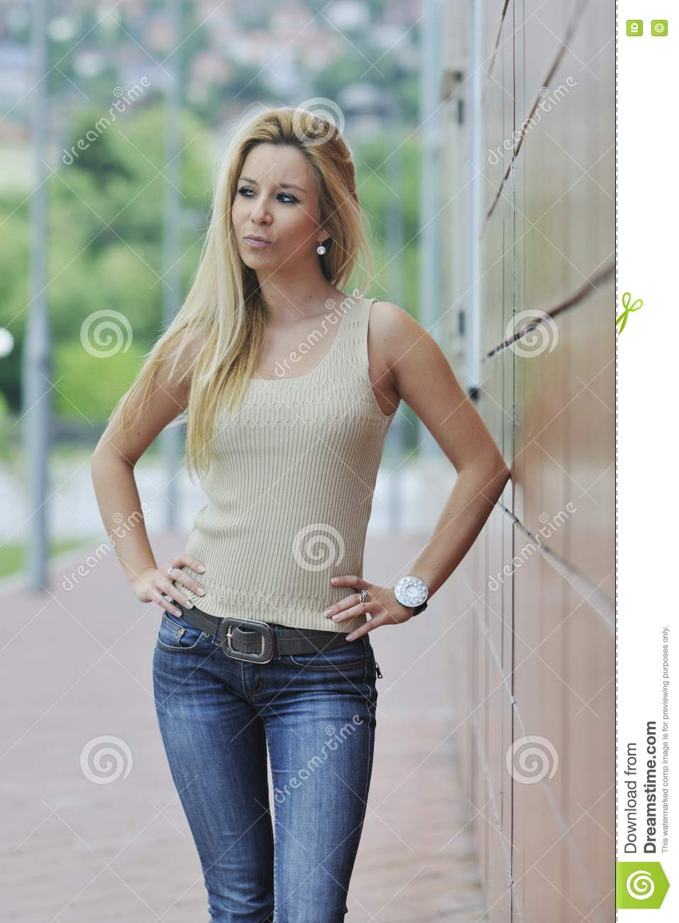 Woman outdoor in casual fashion clothes representing urban style