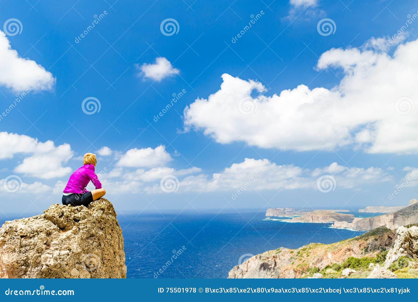 Woman overlooking Mediterranean Sea, Crete Island, Greece