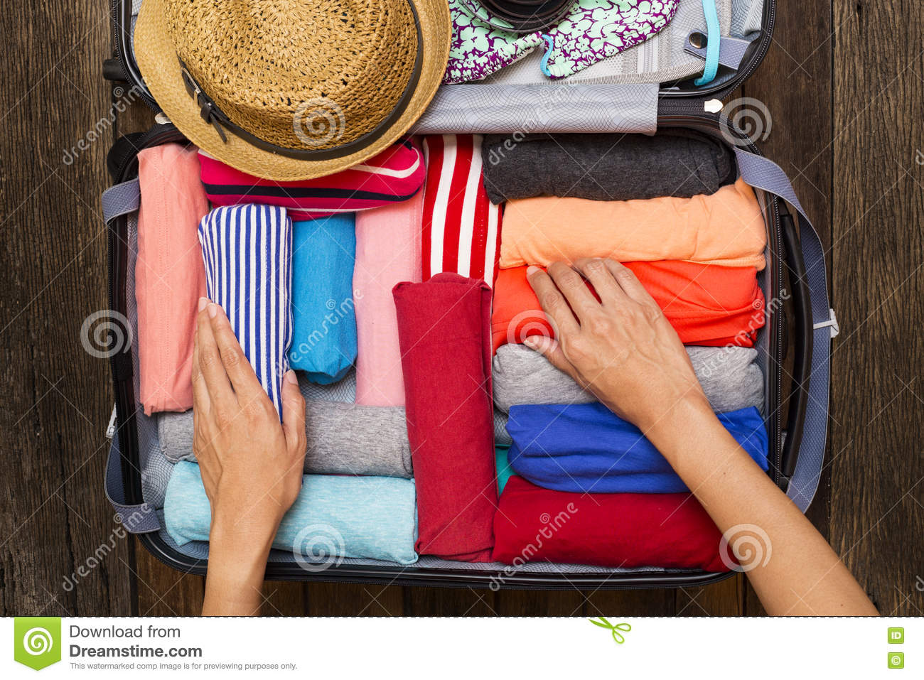 Woman packing a luggage for a new journey