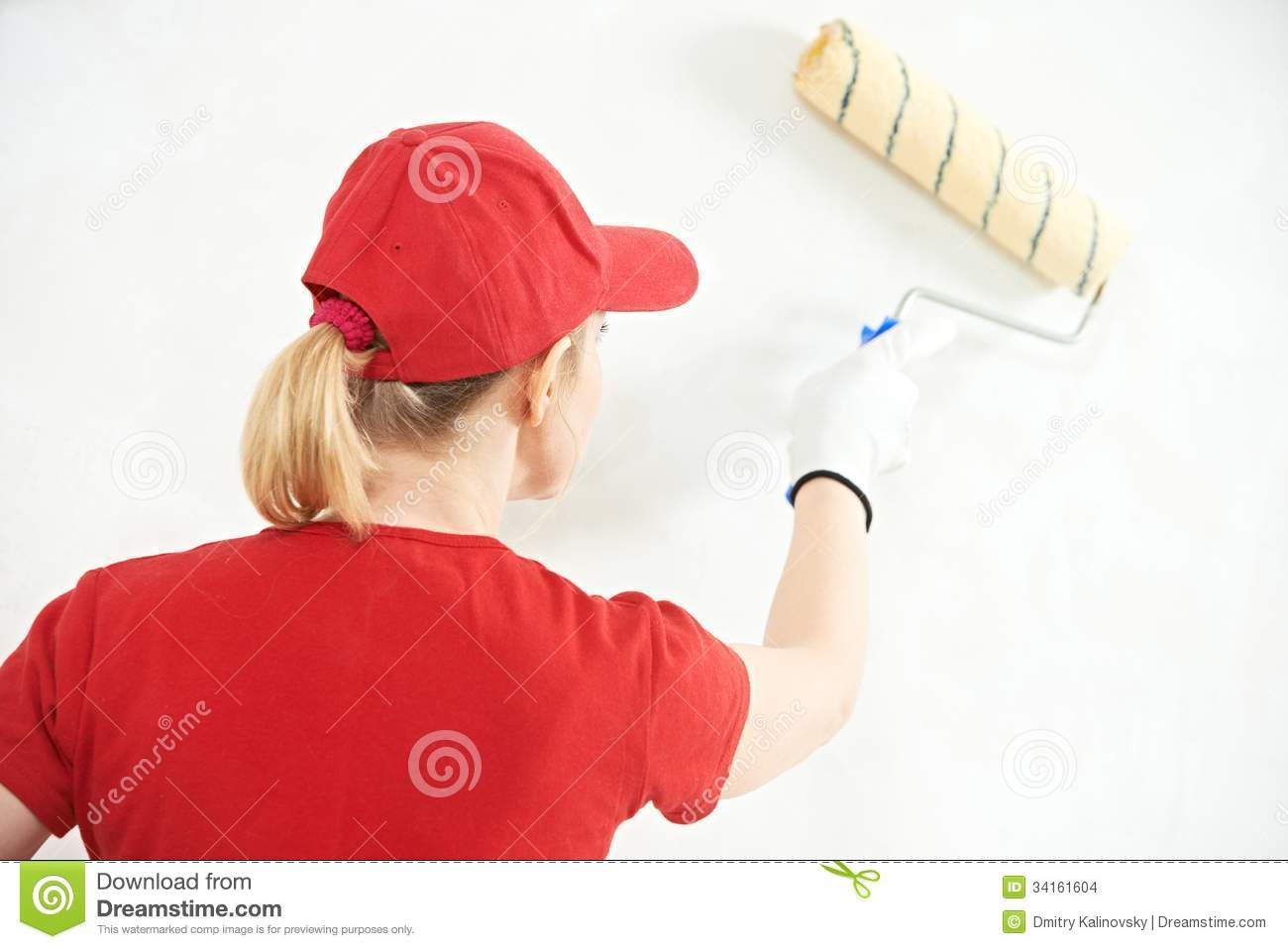 house painter worker painting and priming wall with painting rollerWorker Painting Wall