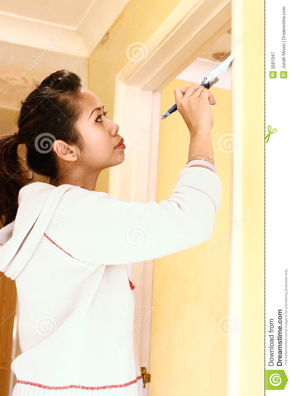 Asian Woman Painting Door Frame In The House.