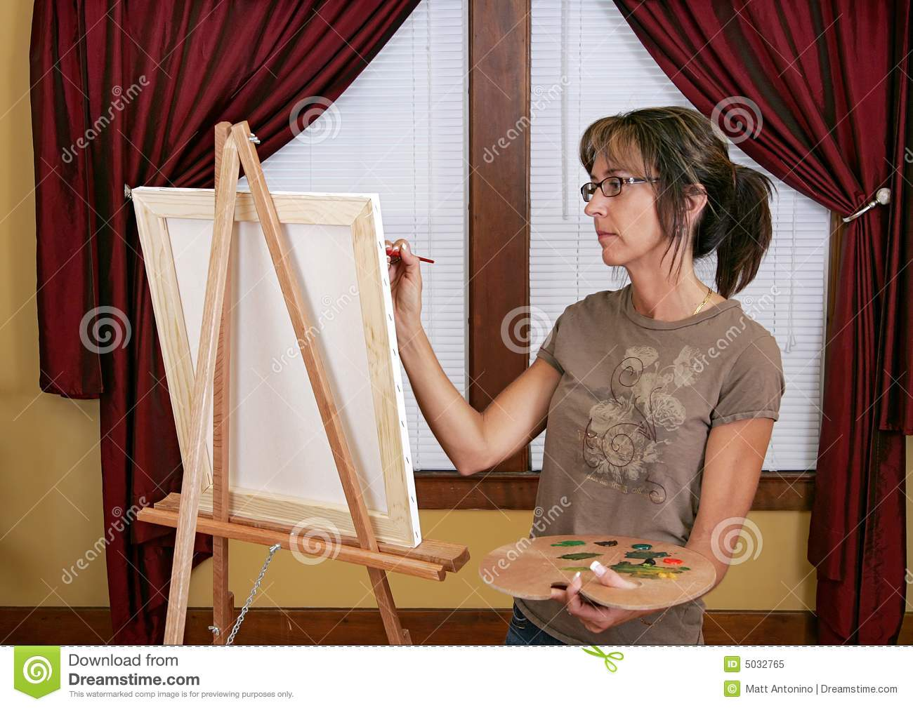 Woman painting at easel stock image. Image of abstract ...